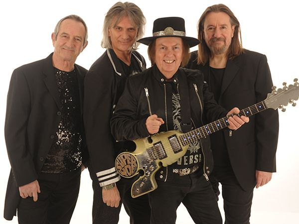 The current Slade line-up, with Dave Hill second right