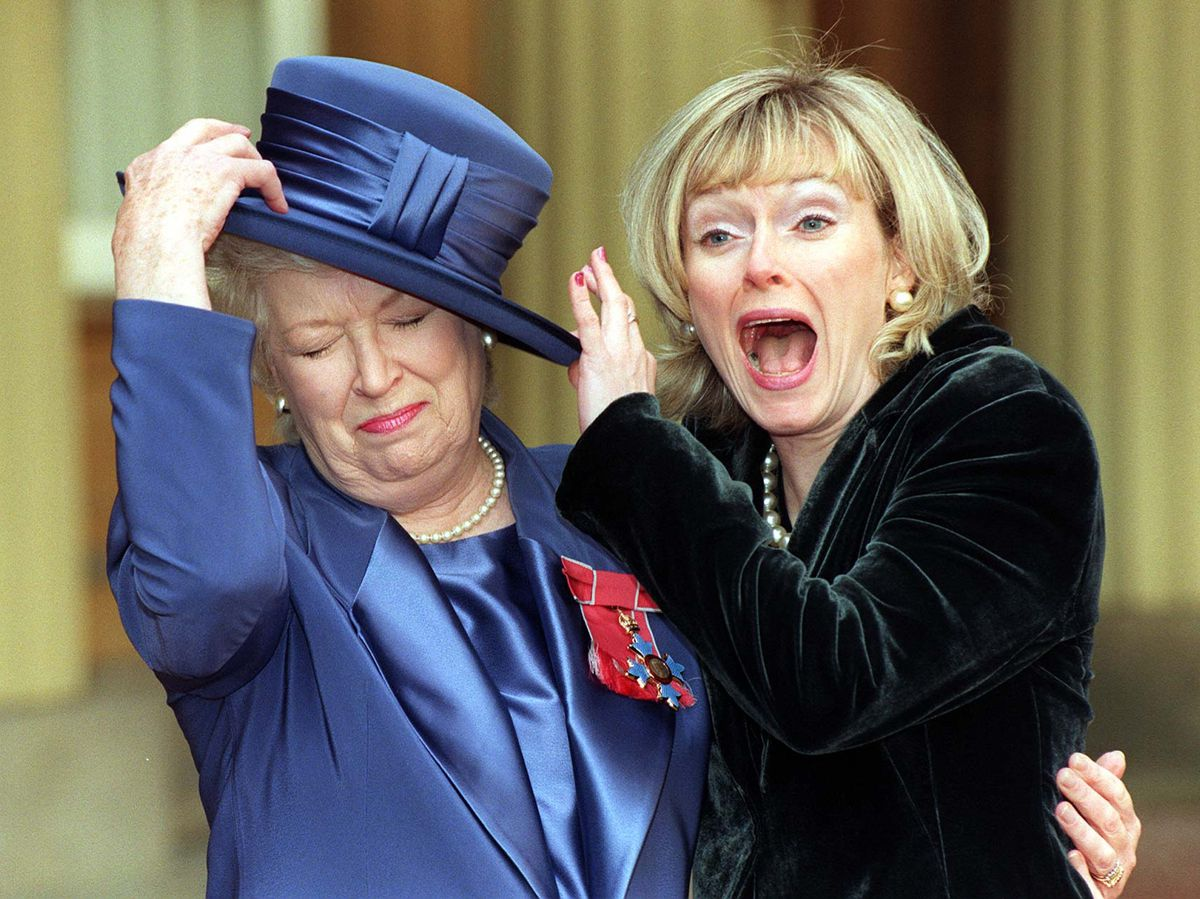 June Whitfield with her daughter, Suzy Aitchison, after being made a CBE for services to comedy drama