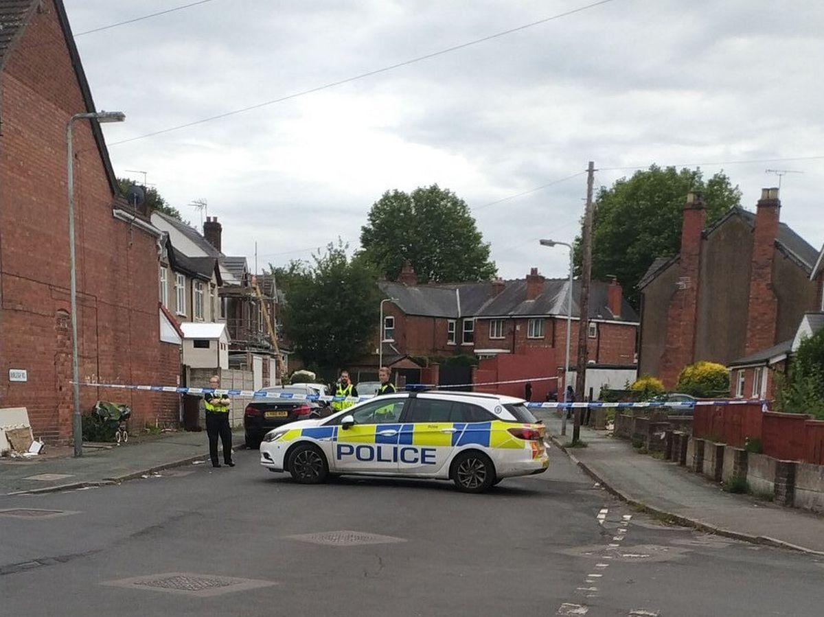 The police cordon in Burleigh Road, Wolverhampton