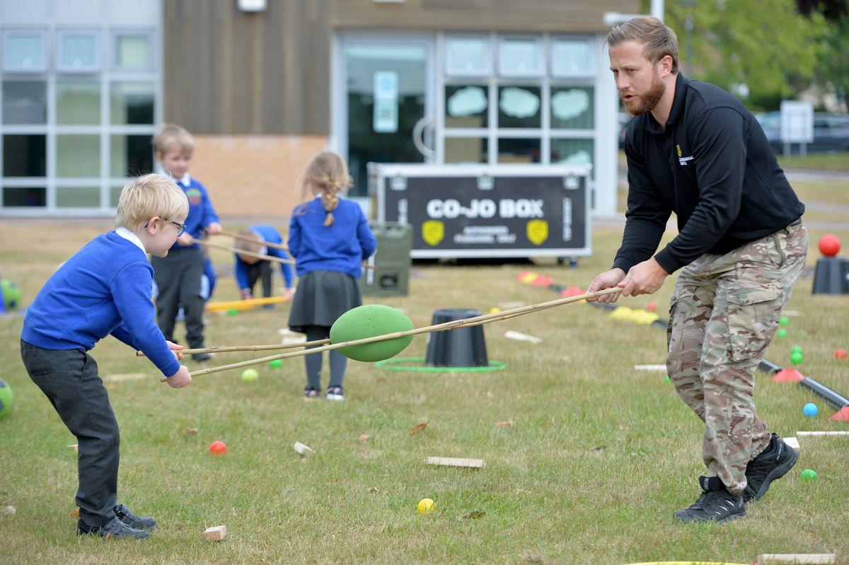 Commando Joe's instructor Stuart Wilkinson with pupils from Landywood Primary School