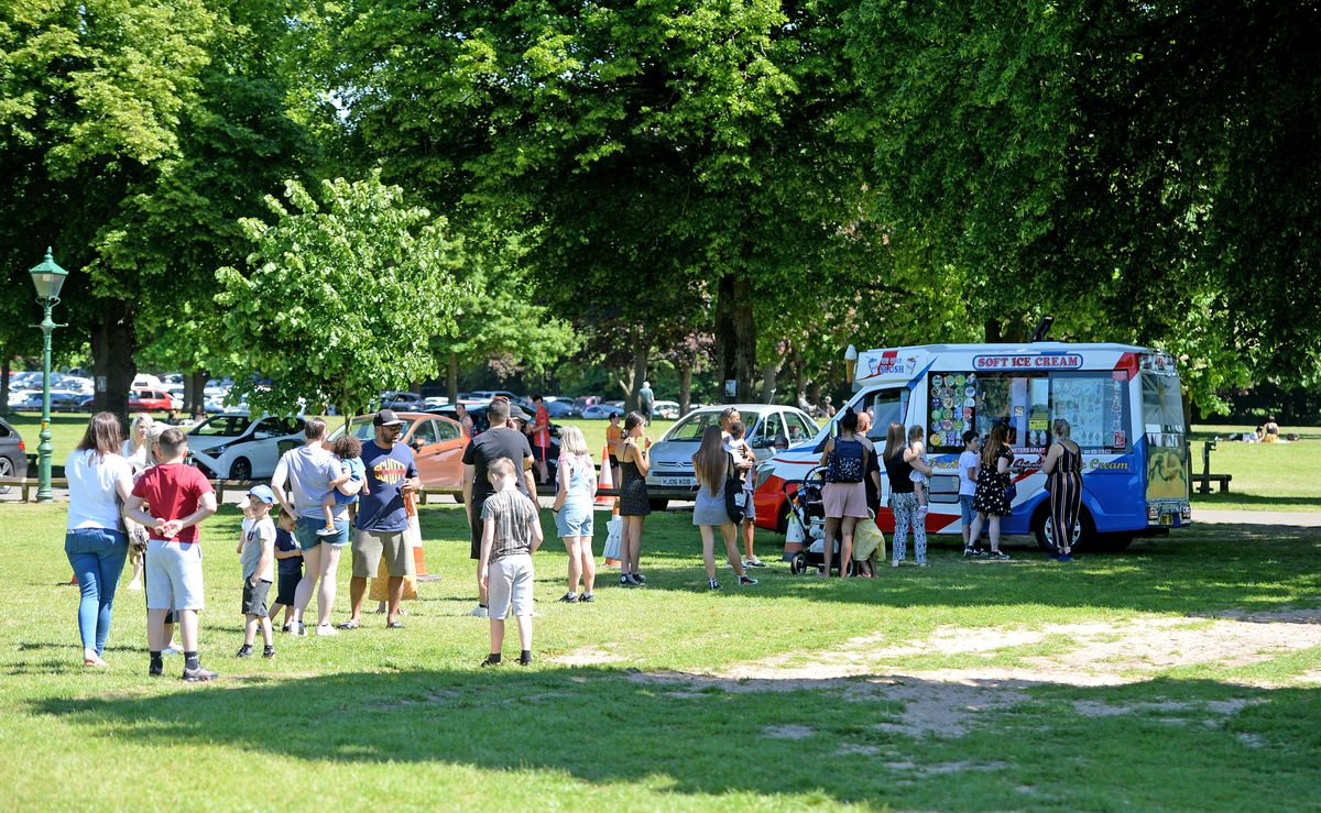 People queue for the ice cream van as Himley Park attracted large crowds of people