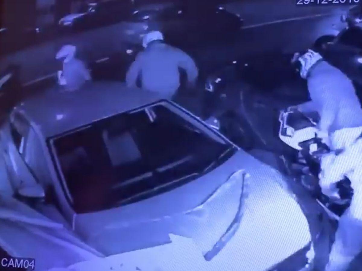 The gang wheel away the motorbike