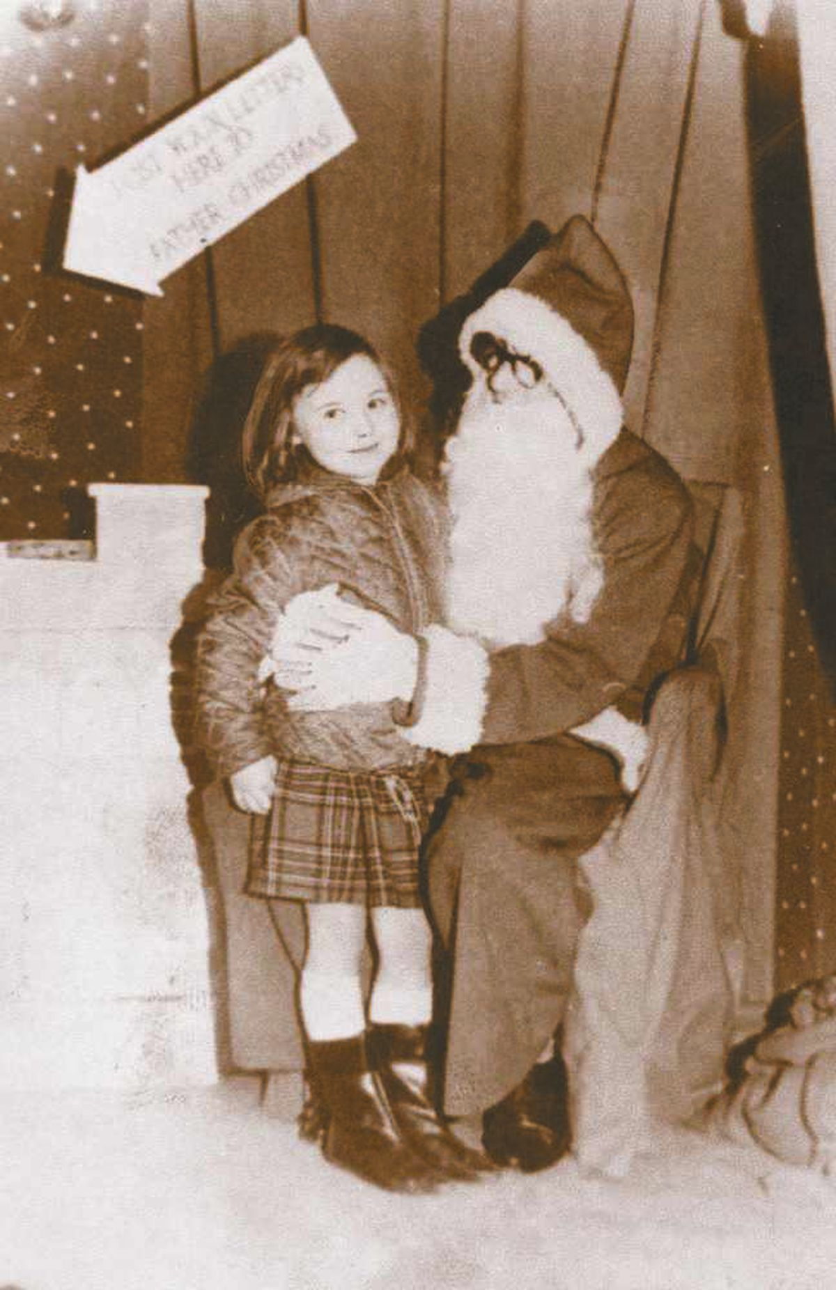 Christine Darby with Santa Claus in 1966
