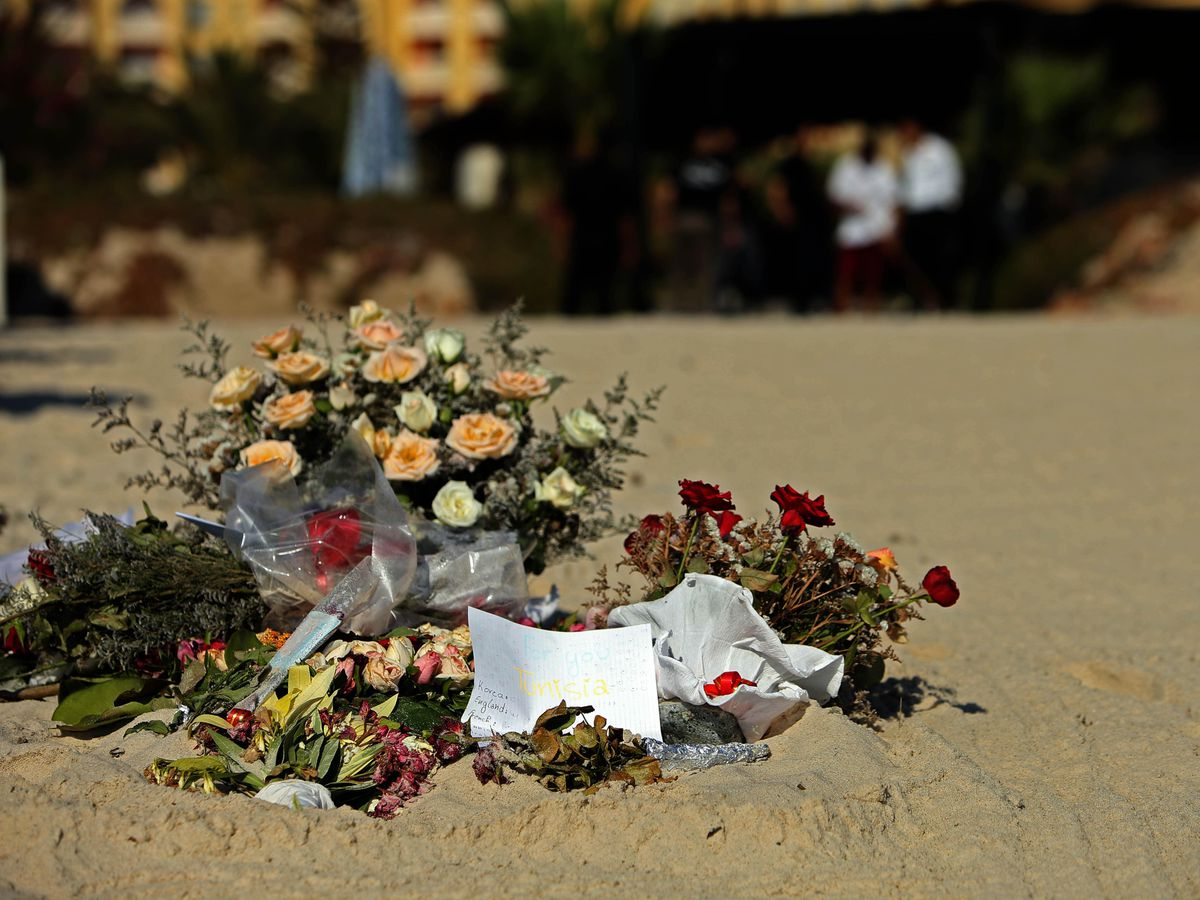 Flowers on the beach near the RIU Imperial Marhaba hotel in Sousse, Tunisia, where 38 people lost their lives after a gunman stormed the beach (Steve Parsons/PA)