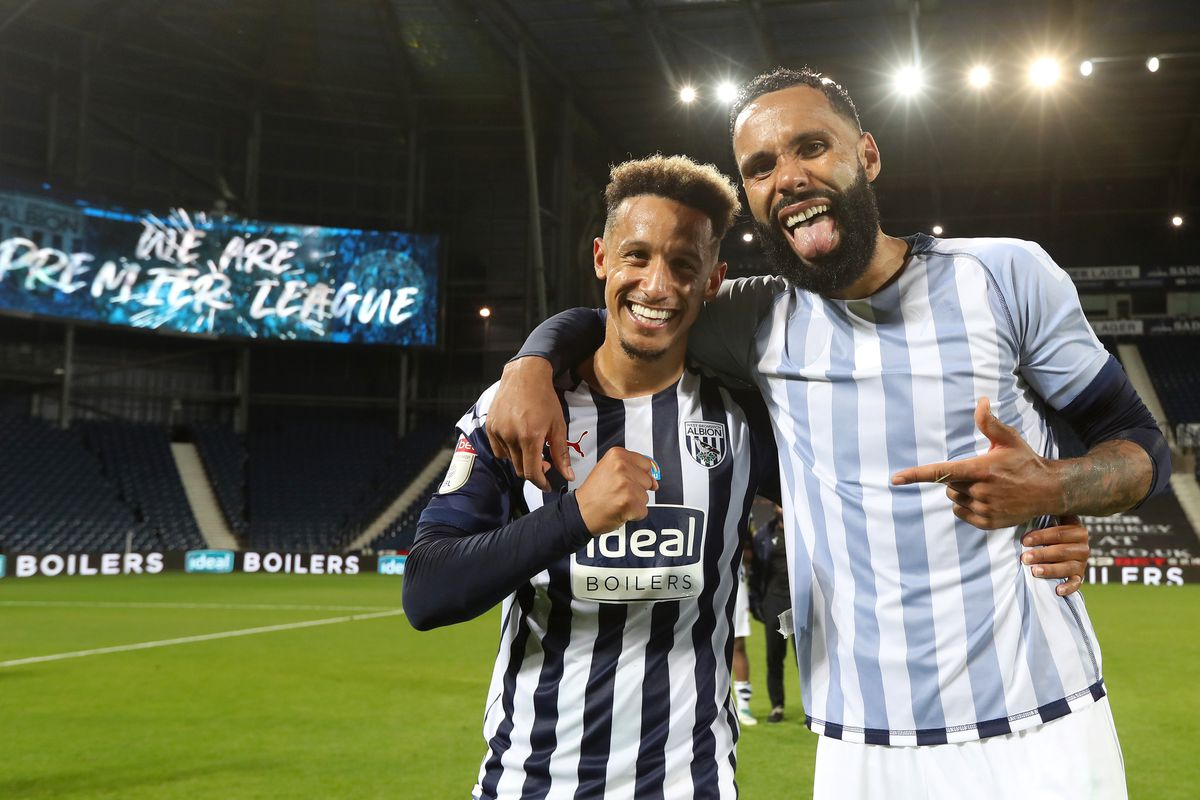 Callum Robinson of West Bromwich Albion  and Kyle Bartley of West Bromwich Albion celebrate promotion to the Premier League on the pitch at the end of the match. (AMA)