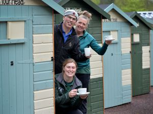 Kaye and Richard Le Page with their daughter Lucy next to one of the forest huts at Springslade Lodge, Cannock Chase.