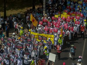 Anti-coup protesters march in Yangon