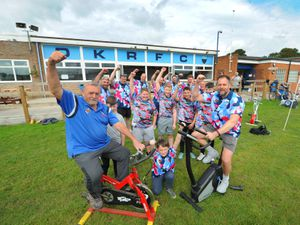 Event organiser Roland Green, Rory Kelly (8), and Damian Watts take to the saddle with members of the Dudley Kingswinford Old Boars and Jaguars ahead of the static cycle ride to Brussels.