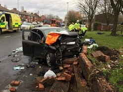 Three seriously injured as two cars crash into wall