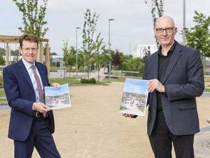 Andy Street, Mayor of the West Midlands and Robert Flavell, senior director at St Modwen signing the memorandum