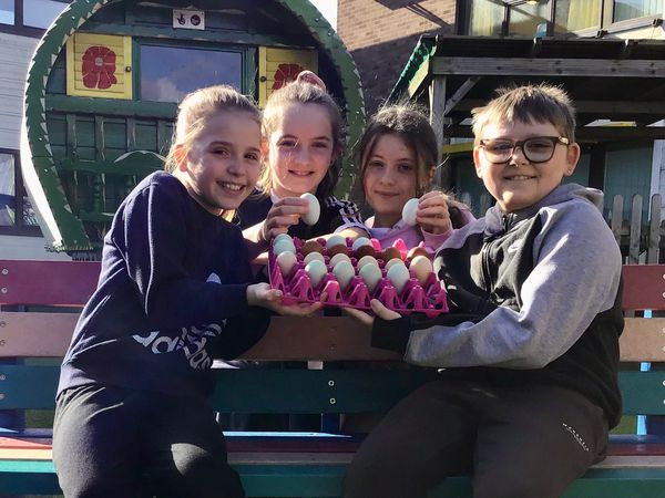 St Bart's pupils Lacey Norton and Thomas Webb and Portia Sutcliffe and Gracie Malinowski with the eggs