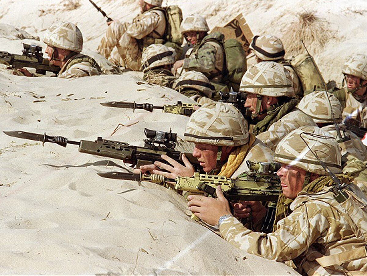 "British soldiers from the First Stafford, well known as the ""Desert Rats"", stand in a trench in January 1991 somewhere in Saudi desert"