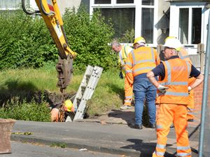 The scene after a sinkhole appeared at Millfields Road, Bilston