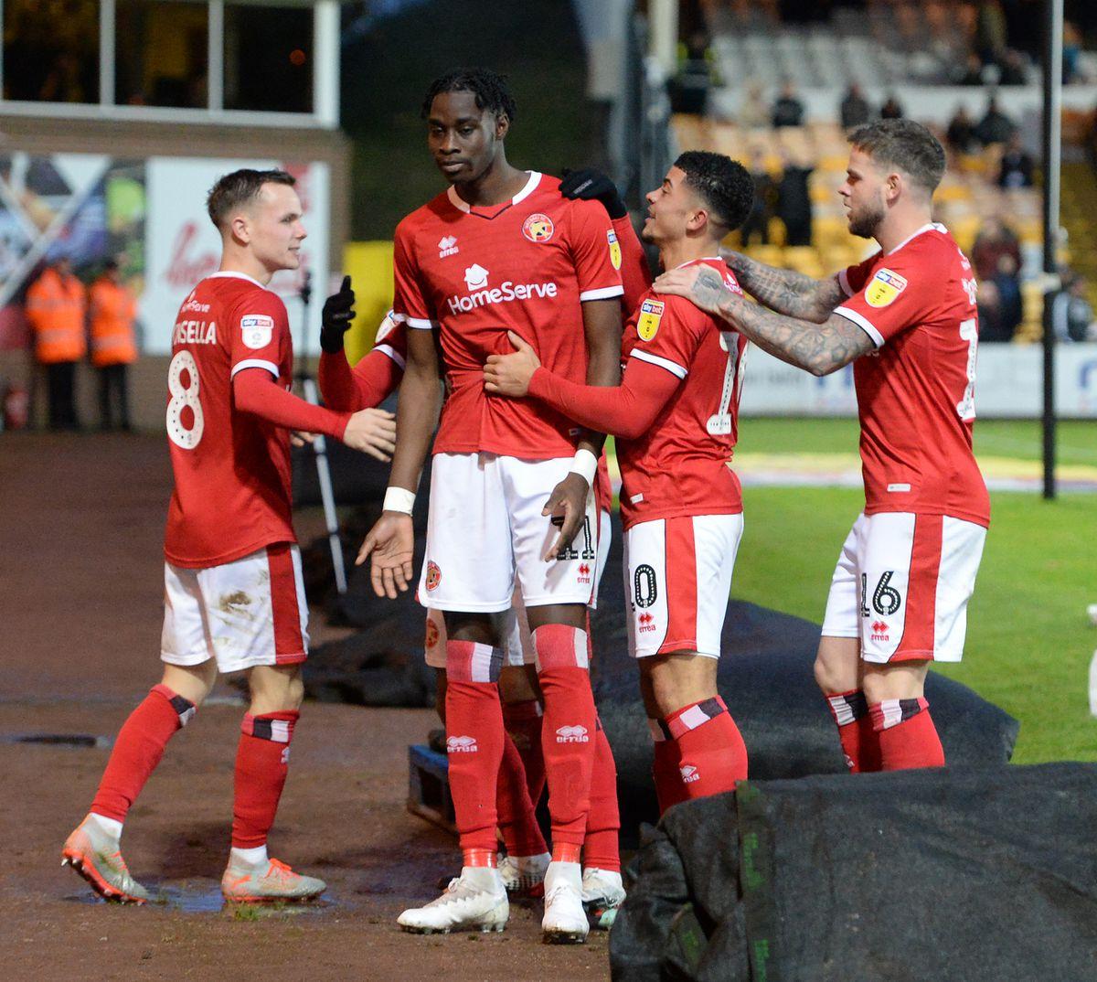 Elijah Adebayo scores and celebrates