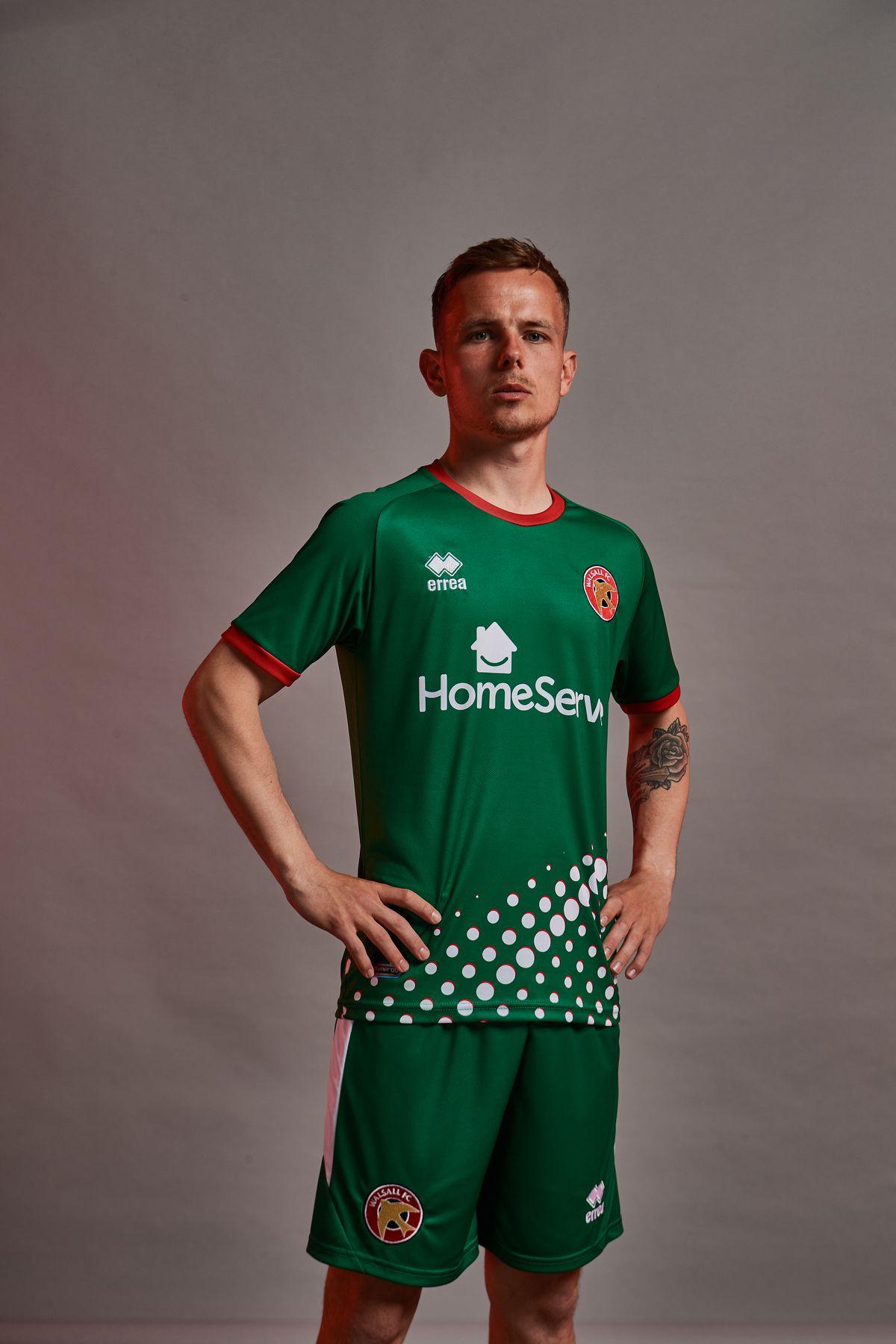 Liam Kinsella models the new away kit