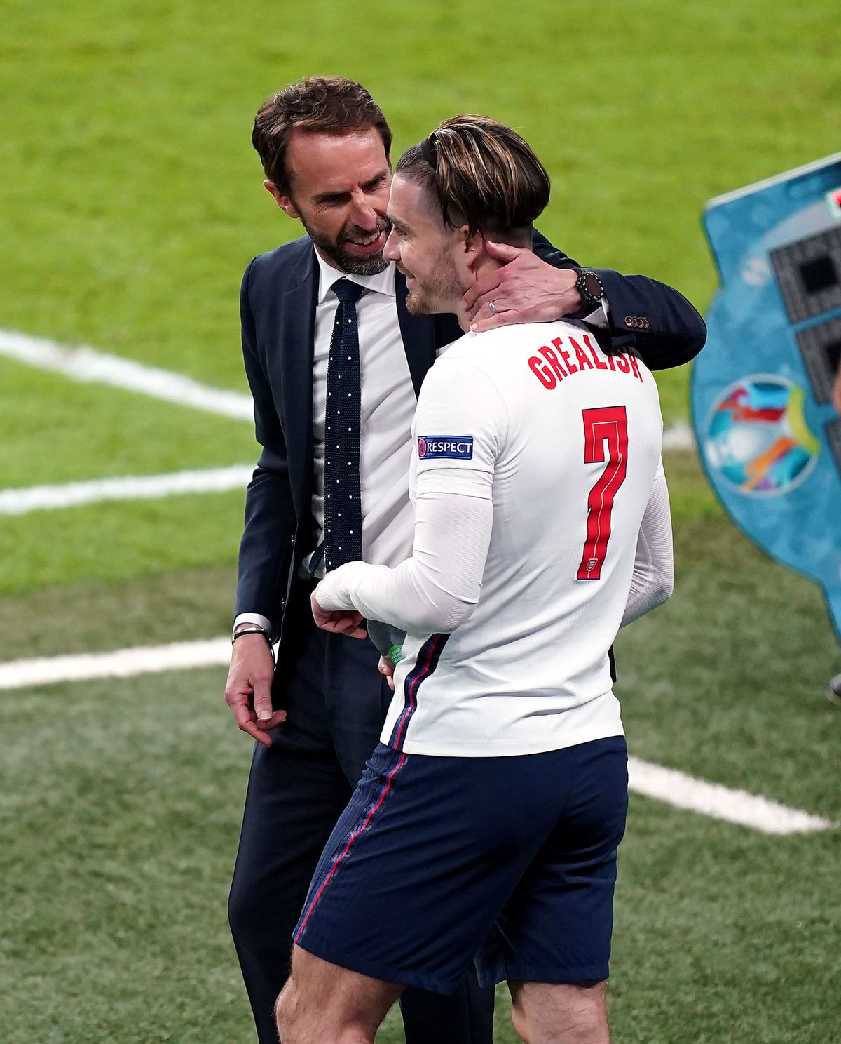 Gareth Southgate speaks to Jack Grealish as he prepares to come on during Wednesday's semi-final.
