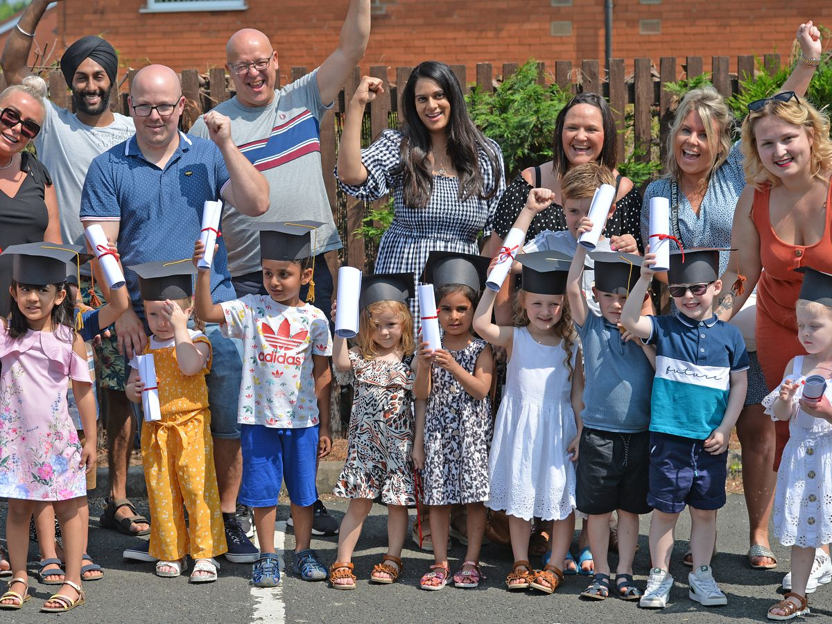Pupils and parents outside the Happy Valley nursery, West Bromwich, as they celebrate graduation