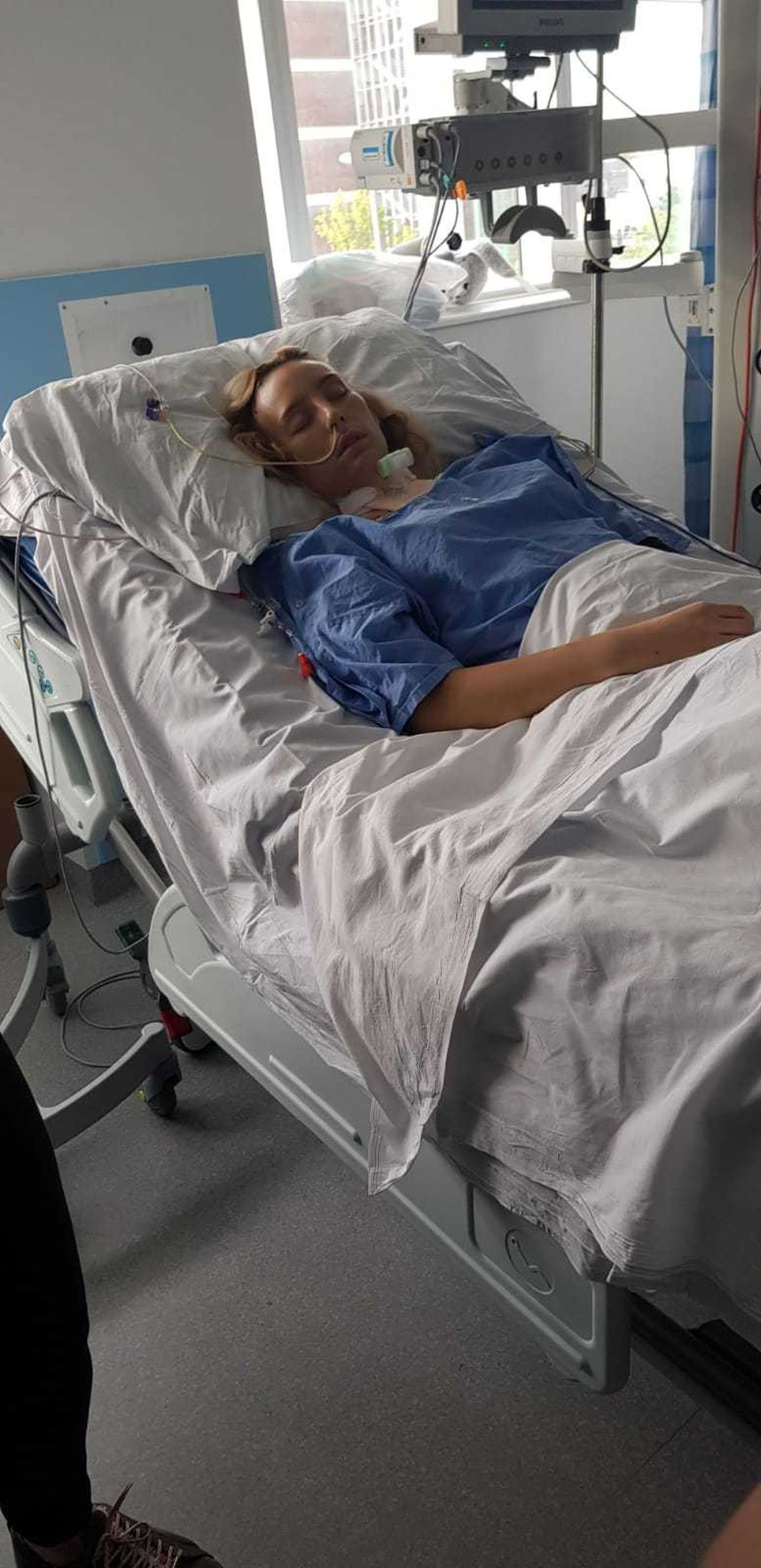 Charlotte 'Lotte' Whittle receives treatment in hospital.
