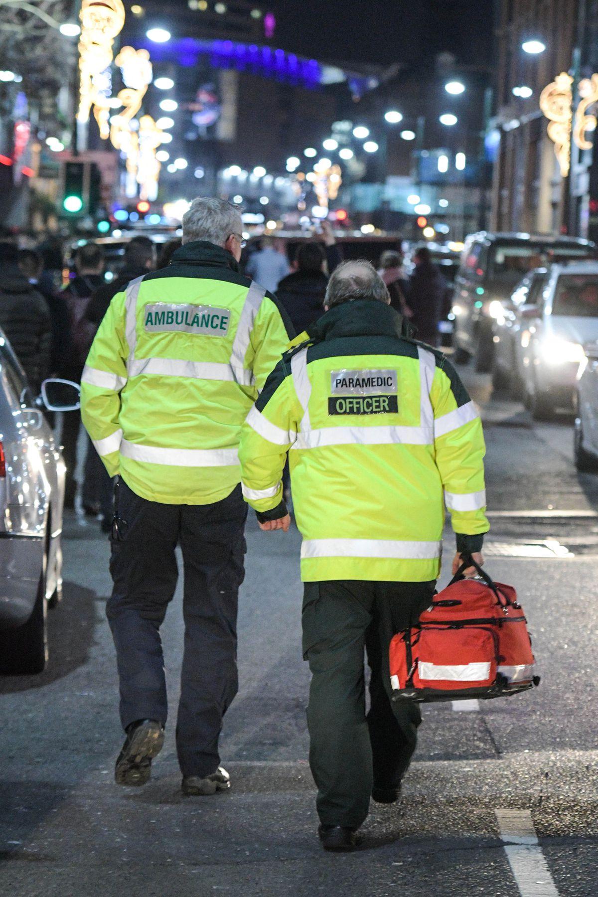 Paramedics walk up Broad Street in Birmingham as revellers partied hard last festive season