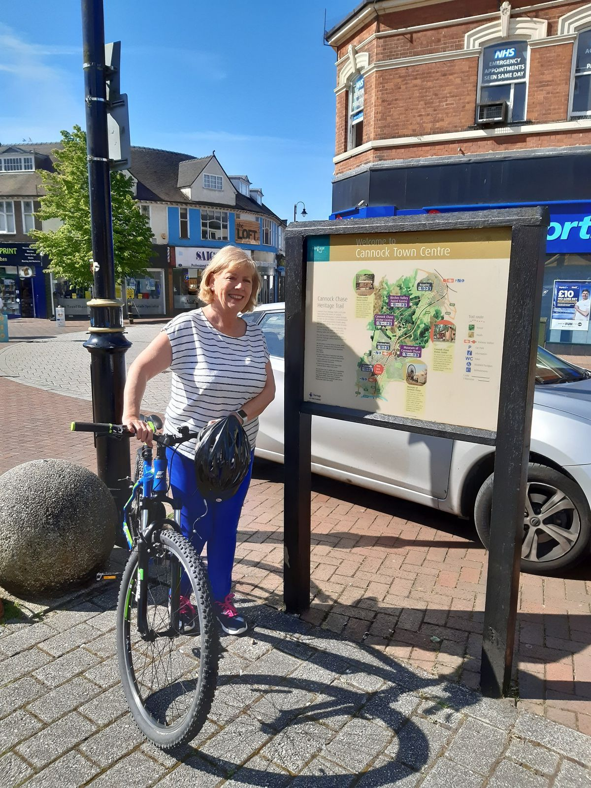 Councillor Adrienne Fitzgerald, Portfolio Holder for Heritage and Leisure, by one of the current Cannock Chase Heritage Trail information boards at High Green in Cannock town centre.