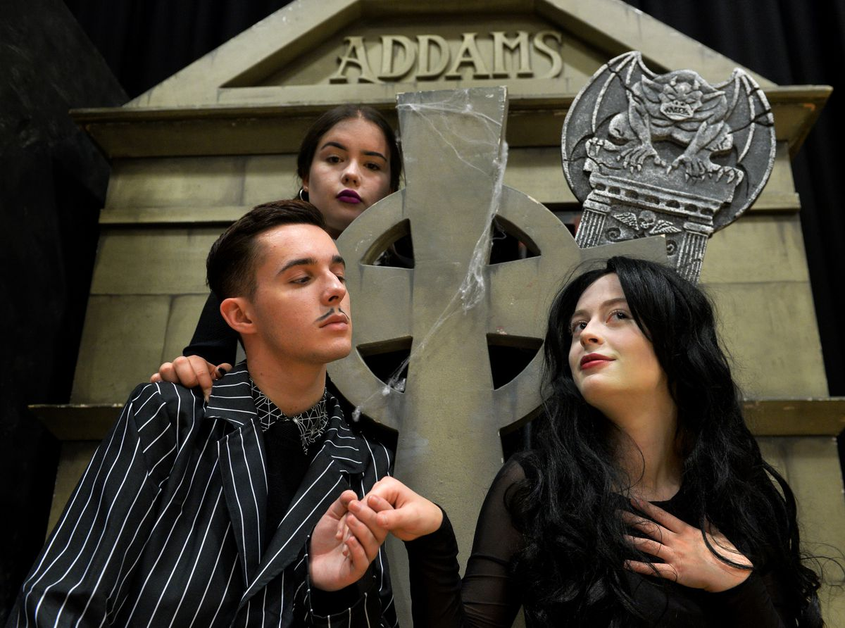 Highfields school production of the Addams family. Pictured left, Owen Whittle as Gomez,Emily Longman as Wednesday and Sophie Bates as Morticia..