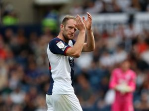 Matt Clarke of West Bromwich Albion applauds the West Bromwich Albion Fans as he is substituted during the second half of the match.