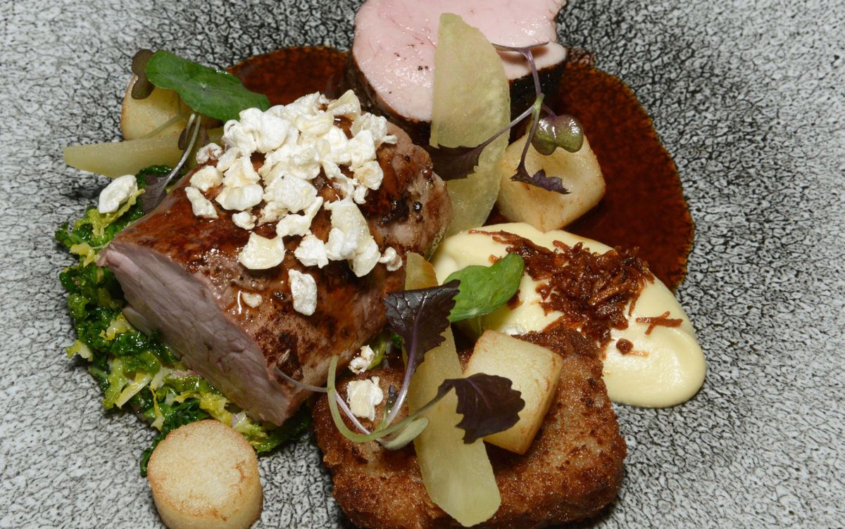 The pork fillet was served with a creamy cauliflower cheese puree, a savoury savoy cabbage and bacon mix, a delicious jus and a small oblong of breaded, fried shoulder