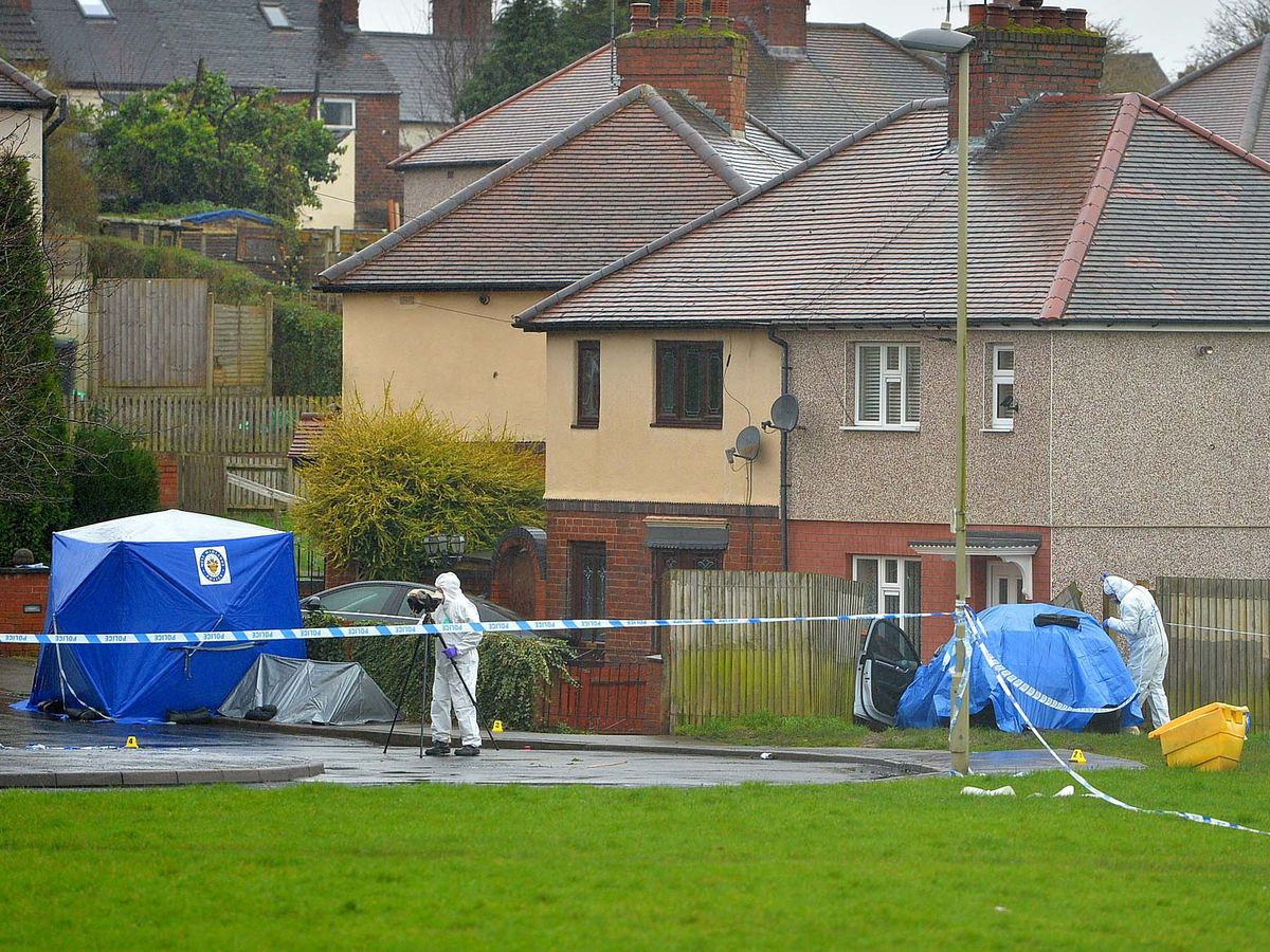 A forensic tent and blue sheet covering a car on Wilson Road, just off Pensnett Road in Brierley Hill