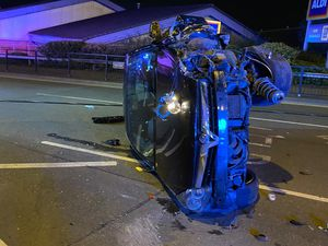 The damaged car on its side after the crash in Brownhills. Image: Aldridge Fire Station