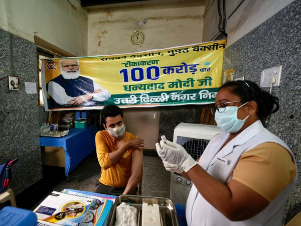 A health worker prepares to give a Covid jab in India