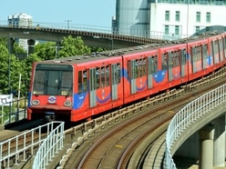 DLR workers plan further walkout in row over pay and conditions
