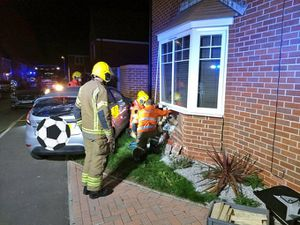 The car crashed into a house in Weir Crescent. Photo: @HWFireNCluster