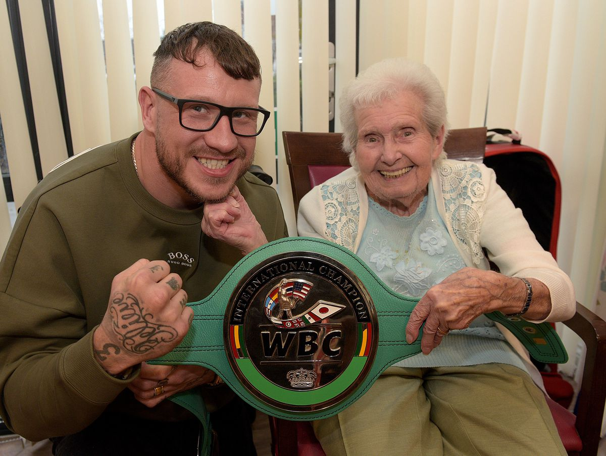Jean Clarke, 84, gives boxing champion Jason Welborn a right hook
