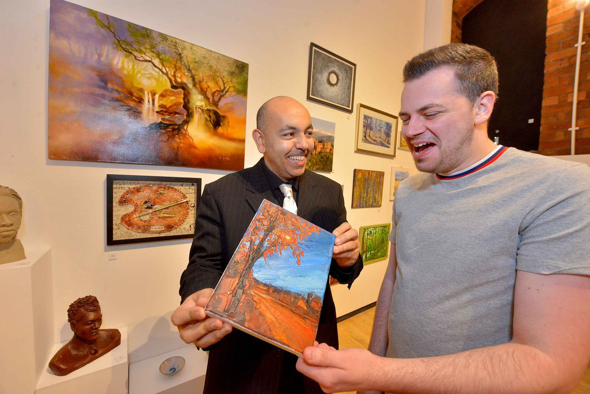 Artist J Valentino with Darryl Griffiths (Front of House) in the exhibition space