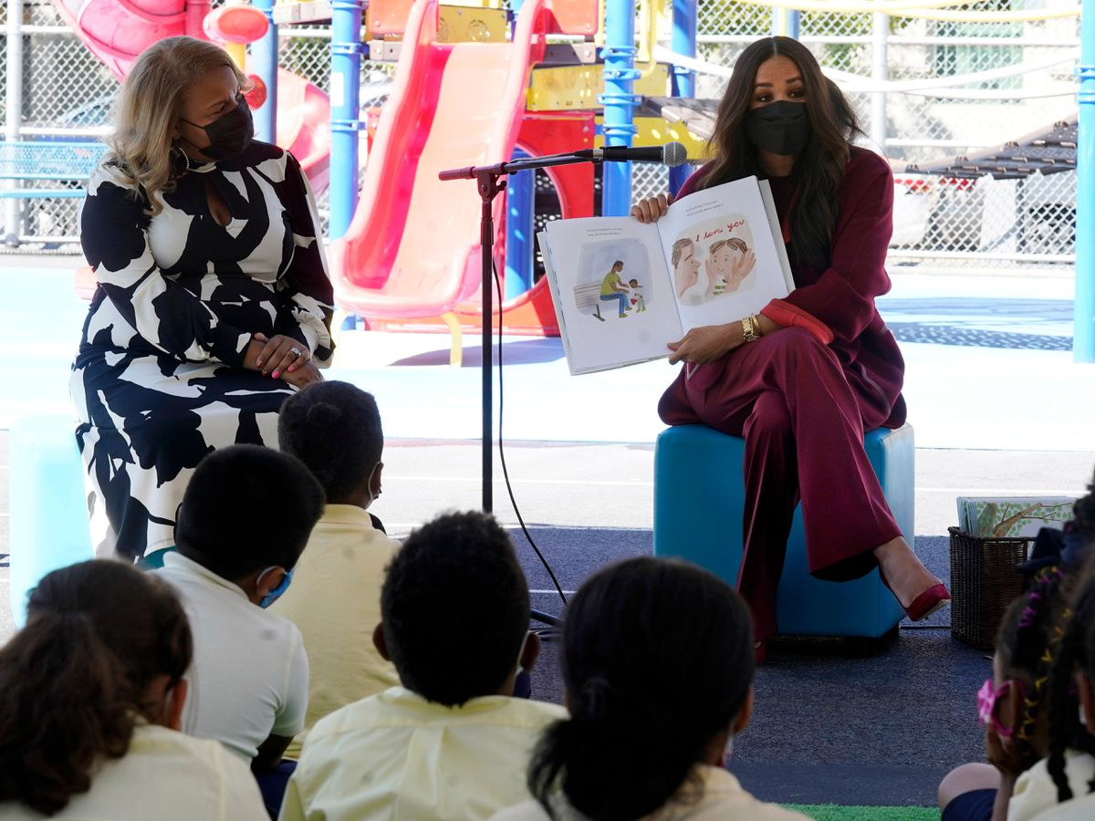 Meghan, the Duchess of Sussex, reads from her book The Bench during her visit with Prince Harry, to PS 123, the Mahalia Jackson School, in New York's Harlem neighbourhood