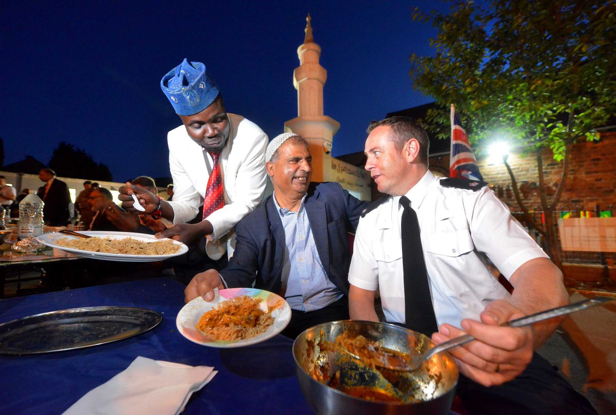 Police Superintendant: Tom Chisholm shares food with L-R: Toby Eprham (National Outreach for the community) and Mosque President: Mohammed Yaseen Khan..