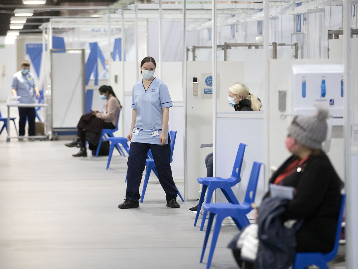 Woman waits for vaccine