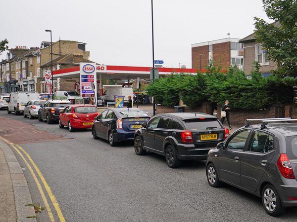 Motorists queue at an Esso petrol station