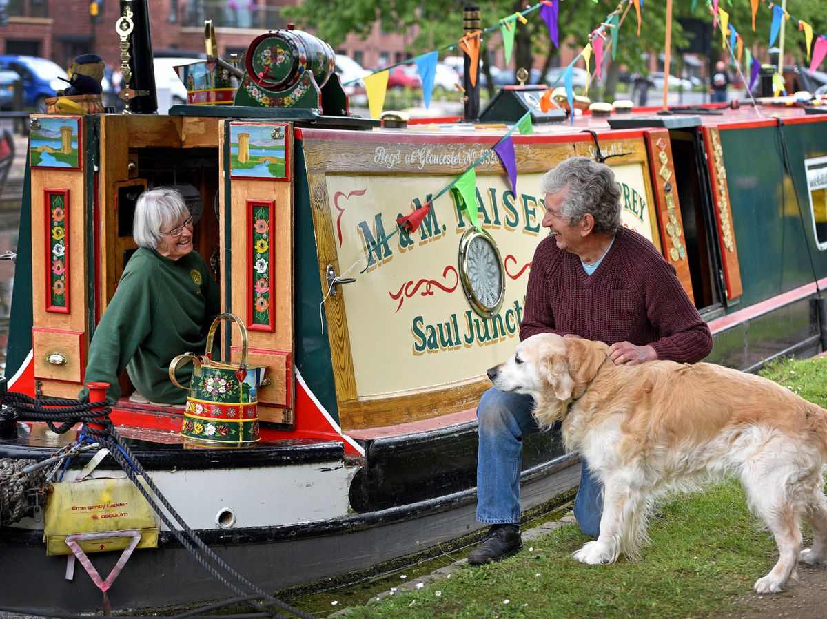 Marion and Mike Paisey, with their dog Pickles, enjoying Brownhills Canal Festival
