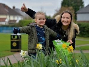 George Rudge, aged three, with mom Abigail Rudge has cleared up Claregate Park.