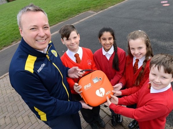 Football club helps school net lifesaving equipment