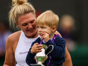 Yui Kamiji (not pictured) and Jordanne Whiley celebrate with the trophy after winning their Ladies' Wheelchair Doubles Final match against Kgothatso Montjane and Lucy Shuker on day twelve of Wimbledon at The All England Lawn Tennis and Croquet Club, Wimbledon. Picture date: Saturday July 10, 2021. PA Photo. See PA story TENNIS Wimbledon. Photo credit should read: Steven Paston/PA Wire   RESTRICTIONS: Editorial use only. No  commercial use without prior written consent of the AELTC. Still image use only - no moving images to emulate broadcast. No superimposing or removal of sponsor/ad logos.