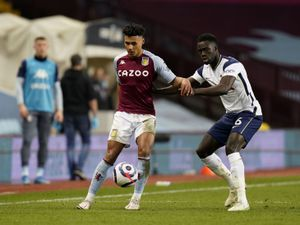 """Aston Villa's Ollie Watkins (left) and Tottenham Hotspur's Davinson Sanchez (right) battle for the ball during the Premier League match at Villa Park, Birmingham. Picture date: Sunday March 21, 2021. PA Photo. See PA story SOCCER Villa. Photo credit should read: Tim Keeton/PA Wire.    RESTRICTIONS:  EDITORIAL USE ONLY No use with unauthorised audio, video, data, fixture lists, club/league logos or """"live"""" services. Online in-match use limited to 120 images, no video emulation. No use in betting, games or single club/league/player publications."""