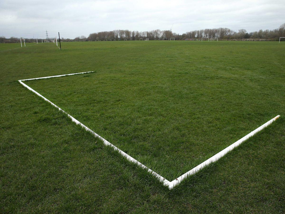Goalposts lie on a football pitch