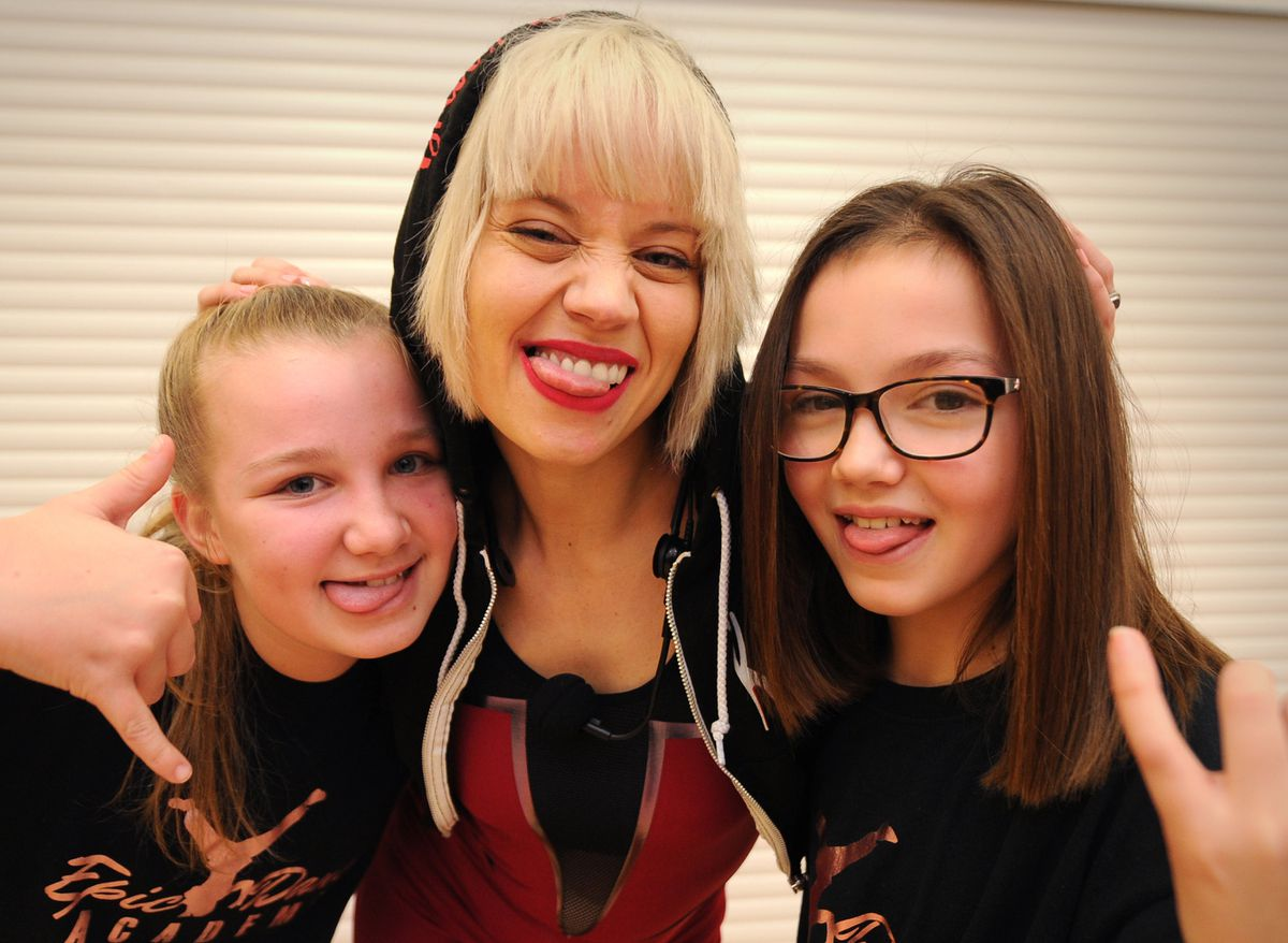 Kimberly Wyatt, during her visit to lead a dance class, at Haden Hill Leisure Centre, Cradley Heath, meeting (left) Emily Bowdler, 11, of Pelsall, and (right) Libby Mae, 11, of Pelsal