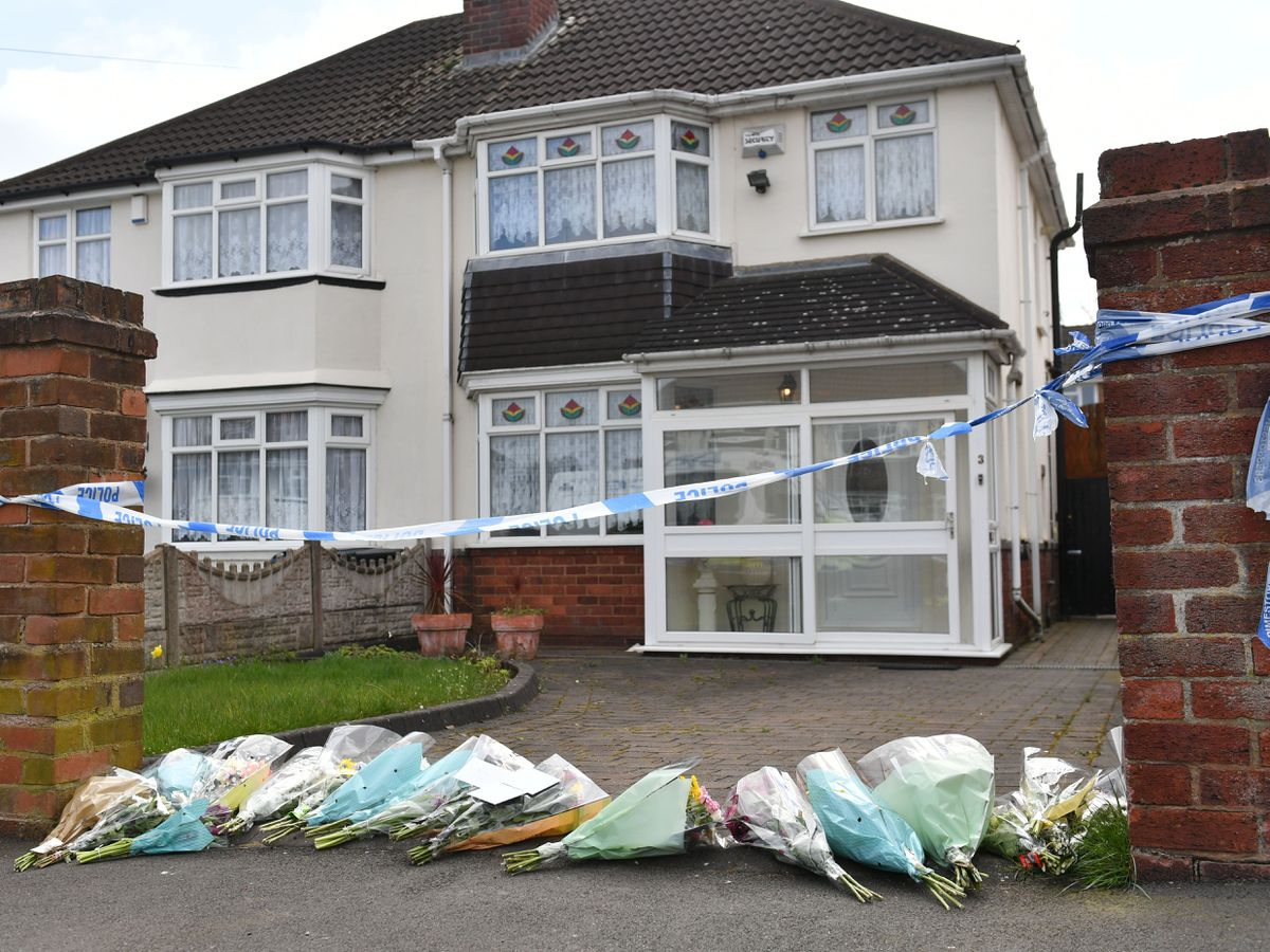 Flowers outside the house on Boundary Avenue where an 85-year-old woman died after being attacked by two escaped dogs