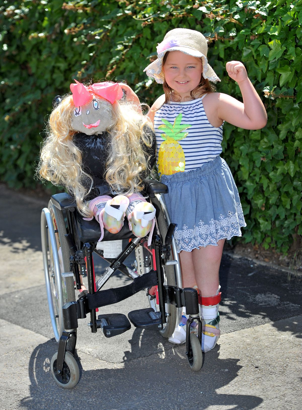 Five year old Amelia-Mae Smith, who has created a scarecrow in a wheelchair based on herself