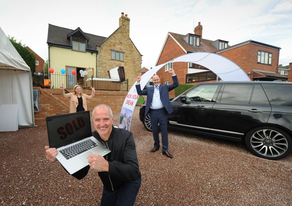 Selecting the winner of a house and car, Steve Bull, with homeowner Lydia Browning and promoter Mike Chatha, at Catholic Lane, Sedgley