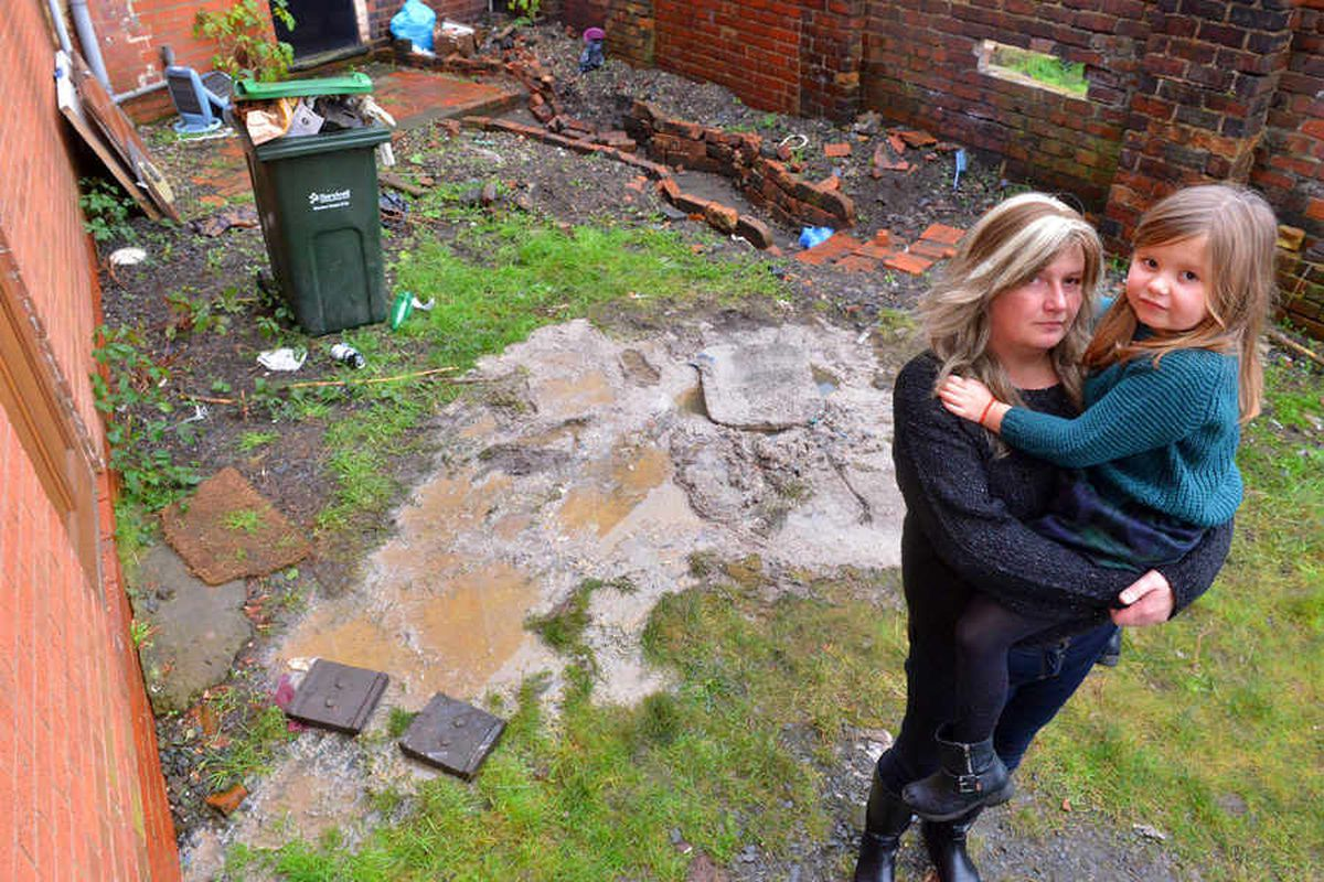 'We can't live like this': Sewage flows into back garden from manhole to the dismay of mother