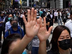 Police fire tear gas as Hong Kong protesters disrupt peak hour trains